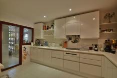 Fitted kitchen with utility room